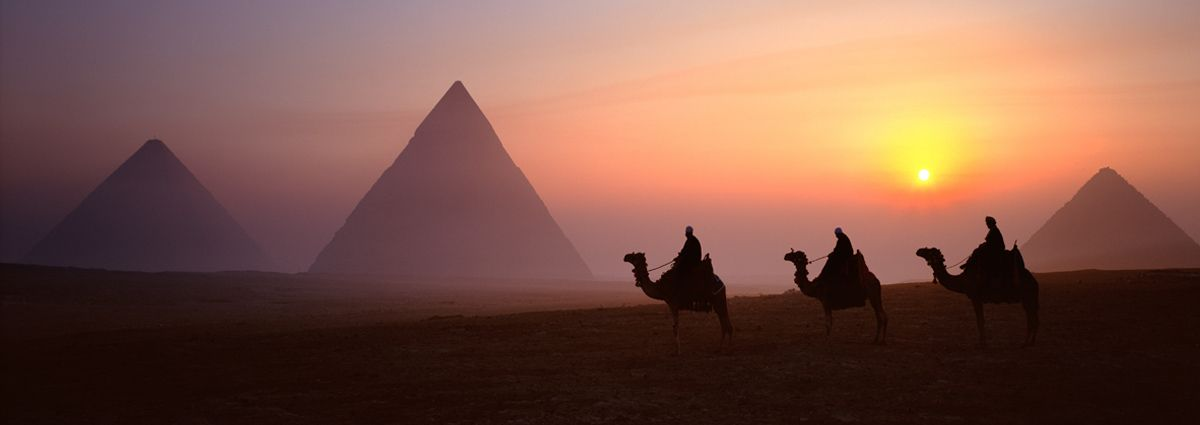 image of giza pyramids at sunset in cairo